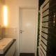 Elegantes Lichtdesign im kleinen Bad nachher